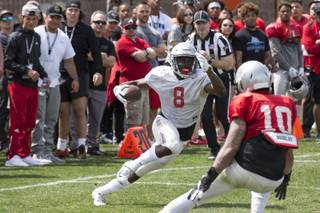 Running back Charles Williams (8) looks for an opening against Vic Viramontes (10) during the UNLV football team's Spring Showcase at the Peter Johann Memorial Field at UNLV on Saturday, April 6, 2019. Richard Brian