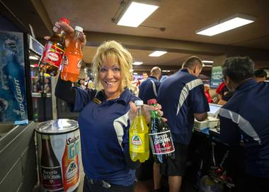 Bartender Theresa McWilliams poses with Jarritos soda and other Mexican soft drinks before a game between the Las Vegas Lights FC and the Tacoma Defiance at Cashman Field Saturday, April 13, 2019. The Lights shut out the Defiance 5-0.