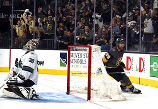 Vegas Golden Knights right wing Alex Tuch (89) celebrates after scoring on San Jose Sharks goaltender Aaron Dell (30) in the third period of Game 4 of an NHL hockey first-round playoff series at T-Mobile Arena Tuesday, April 16, 2019.