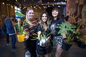 Whitney Welch Davis, left, Patricia Castro, center, and Brooklyn Martell pose during a downtown plant swap event at Cornish Pastry Company Friday, April 5, 2019.