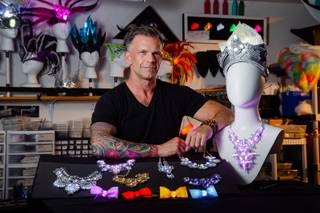 Ronnie Brust, owner and designer for Good to Glow, a light up wearables company, poses for a photo in his studio Monday, April 29, 2019.