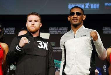 Canelo Alvarez, left, and Daniel Jacobs pose for photographers at a news conference for their middleweight title boxing match Wednesday, May 1, 2019, in Las Vegas. The two are scheduled to fight Saturday in Las Vegas.