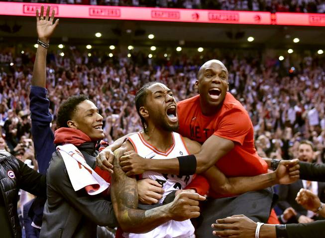 Raptors advance at buzzer