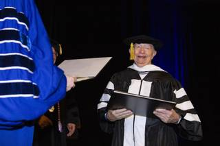 Ninety-two-year-old Holocaust survivor Daniel Szafran smiles as he receives a doctorate of humane letters degree from Touro University Nevada during a spring commencement ceremony at Westgate Monday, May 13, 2019. Twenty-one Holocaust survivors were honored Monday with the honorary degrees.