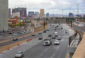 A view of northbound traffic on I-15 from a High Occupancy Vehicle (HOV) flyover bridge connecting I-15 with U.S. 95 at the Spaghetti Bowl Thursday, May 16, 2019.