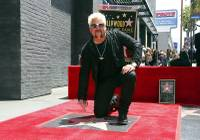 For one day, Hollywood became Flavortown as celebrity chef Guy Fieri on Wednesday got his star on the star-studded Walk of Fame ...
