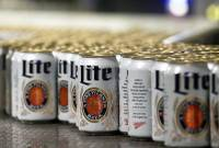 A Wisconsin judge on Friday ordered Anheuser-Busch to stop suggesting in advertising that MillerCoors' light beers contain corn syrup, wading into a fight between ...