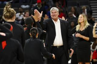 Head Coach Bill Laimbeer and Assistant Coach Kelly Raimon, back right, high five the Las Vegas Aces at the start of the Aces' home opener against the Los Angeles Sparks at Mandalay Bay Event Center Sunday, May 26, 2019.