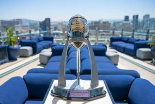 The Las Vegas Bowl Rossi Ralenkotter trophy is seen at the Apex Social Club in the Palms Resort Las Vegas during an announcement about the Mitsubishi Motors Las Vegas Bowl 2020 football game at the Apex Social Club in the Palms Resort Las Vegas on Tuesday, June 4, 2019. Officials announced that the 2020 Las Vegas Bowl will be played at the Las Vegas Stadium between a Pac-12 Conference team and either an SEC or Big Ten Conference team.