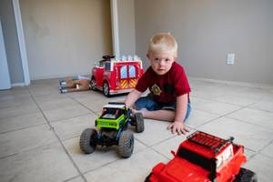 Xavier Nolen, 4, plays with a toy truck inside his new home on Monday, June 3, 2019.
