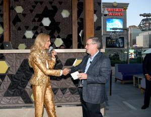 Celine Dion (L) and Tony Rodio, Caesars Entertainment CEO pose ...