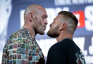 Heavyweight boxers Tyson Fury, left, of England and Tom Schwarz of Germany face off during a final news conference at the MGM Grand Wednesday, June 12, 2019. The boxers will headline a card at the MGM Grand Garden Arena Saturday, June 15.