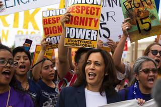 Democratic presidential candidate Sen. Kamala Harris, center, D-Calif., marches with Fight For 15 protestors during a demonstration by a McDonald's restaurant at Flamingo Road and Eastern Avenue in Las Vegas Friday, June 14, 2019. STEVE MARCUS