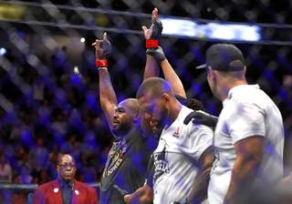 UFC light heavyweight champion Jon Jones, left, is announced as the winner over Thiago Santos of Brazil during UFC 239 at T-Mobile Arena Saturday, July 6, 2019. Jones retained his title by split decision.