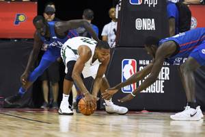 Milwaukee Bucks guard Sterling Brown grabs a loose ball from the Philadelphia 76ers during their NBA Summer League game Friday, July 5, 2019, at the Thomas & Mack Center in Las Vegas.