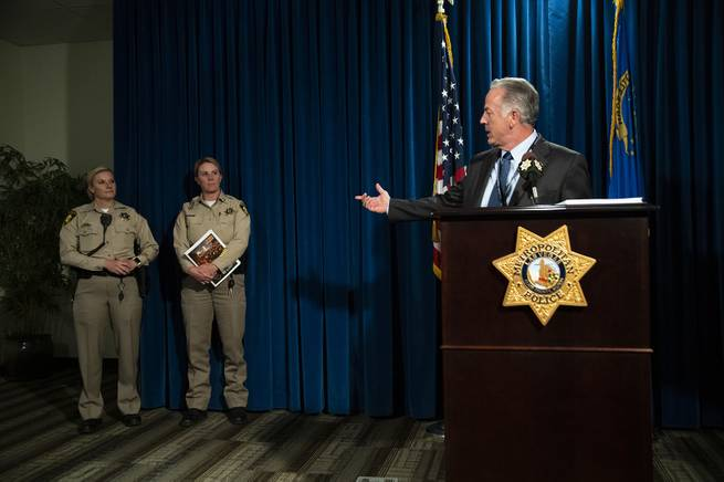 Clark County Sheriff Joe Lombardo introduces the authors of the 1 October After-Action Review report Detective Stephanie Ward, left, and Capt. Kelly McMahill during a news conference at Metro Police headquarters on Wednesday, July 10, 2019.