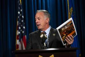 Clark County Sheriff Joe Lombardo holds up a copy of the 1 October After-Action Review report during a press conference at the Las Vegas Metropolitan Police Headquarters on Wednesday, July 10, 2019.