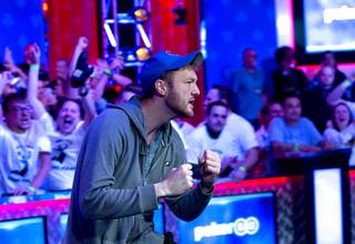 Kevin Maahs of Chicago celebrates after knocking out Zhen Cai, of Lake Worth, Fla. at the final table during the World Series of Poker Main Event at the Rio Sunday, July 14, 2019. Can finished in sixth place.