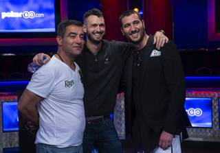Hossein Ensan, left, Alex Livingston, center, and Dario Sammartino, pose at the end of the second day during the World Series of Poker Main Event final table at the Rio hotel-casino in Las Vegas Monday, July 15, 2019.