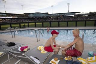 Reed Hawkins, left, and Dax Kunz, both 14, enjoy the outfield pool at Las Vegas Ballpark as the Aviators play the Salt Lake Bees Thursday, July 11, 2019.