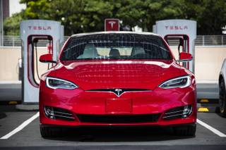 A Tesla vehicle is parked at a new Tesla Supercharger station next to the LINQ High Roller on Tuesday, July 23, 2019.