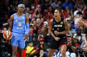 Las Vegas Aces forward Tamera Young, right, celebrates a play against Chicago Sky guard Diamond DeShields, left, during a WNBA game at the Mandalay Bay Events Center Friday, Aug. 9, 2019.