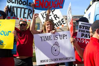 Teacher Jennie Biesinger, center, pickets with other teachers and supporters outside Liberty High School in Henderson Thursday, Aug. 22, 2019. The Clark County Education Association, the largest teachers union in Clark County, has scheduled a strike for Sept. 10 if it doesn't reach an agreement with the Clark County School District.