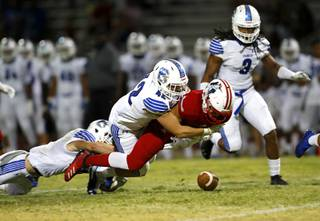 Liberty High School's Edward Gastelum (4) fumbles the ball as he is tackled by Chandler (Ariz.) High School's Kyler Orr during a game in Henderson Friday, Aug. 23, 2019.