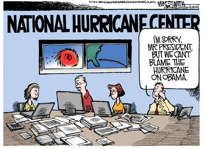 Workers at the National Hurricane Center.  One is speaking into the phone,