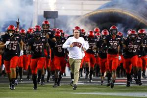 UNLV Rebels head coach Tony Sanchez leads the team onto the field for a game against Arkansas State at Sam Boyd Stadium in Las Vegas Saturday, Sept. 7, 2019.