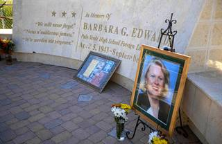 A portrait and flowers are displayed before an annual rededication ceremony for the Barbara G. Edwards Memorial at Palo Verde High School Wednesday, Sept. 11, 2019.  Edwards, a Palo Verde foreign language teacher, was a passenger on American Airlines Flight 77 and died when the plane was crashed into the Pentagon on 9/11.