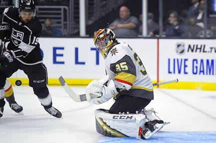 Golden Knights goaltender Oscar Dansk deflects a shot as Kings left wing Alex Iafallo reaches for the puck during the second period of a preseason NHL hockey game Thursday, Sept. 19, 2019, in Los Angeles.