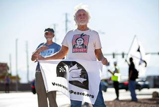 George Killingsworth, center, of Berkeley, Calif. pickets with Fred Bialy, left, of San Francisco at the main entrance to Nellis Air Force Base Thursday, Oct. 3, 2019. Veterans for Peace, Code Pink, and other groups are opposed to a plan that would expand the Nevada Test and Training Range into the Desert National Wildlife Refuge.